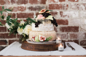 Cheese wheel wedding cake with figd